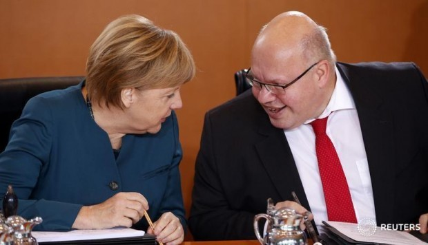 Angela Merkel  y Peter Altmaier