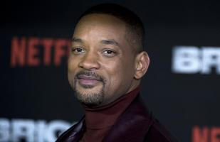 Will Smith se luce en premiere de